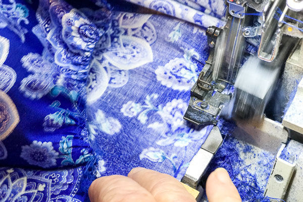 A blue Mandala Twirl Dress is being made sewn by Pamela Winans of Cool Blue Maui.