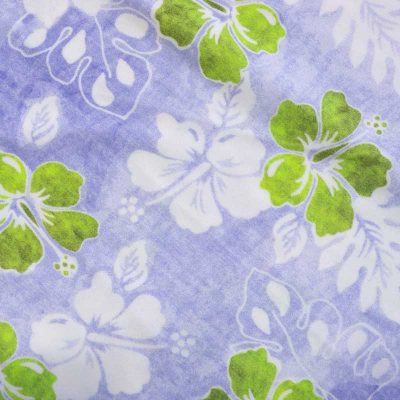 Close up fabric view of Baby Blue by Cool Blue Maui's Haiku Hibiscus Holoholo Dress which has a lavender background with white and lime green hibiscus flowers.