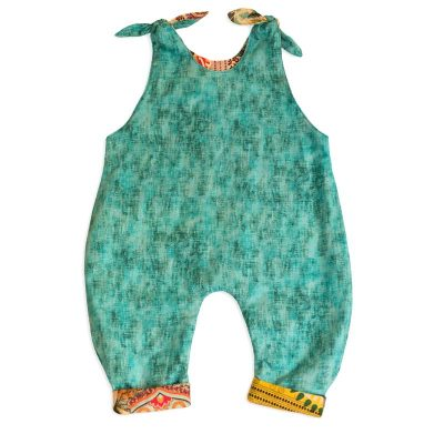 The reverse side view of Baby Blue by Cool Blue Maui's Elephant Walk Romper which has a jade green scratch fabric.
