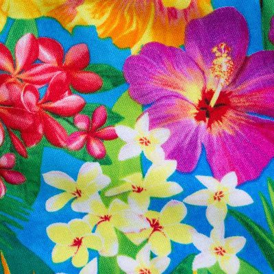 Close up fabric view of Baby Blue by Cool Blue Maui's Aloha Minnie Twirling Dress which has bright yellow, red, purple, and orange assorted Hawaiian tropical flowers.