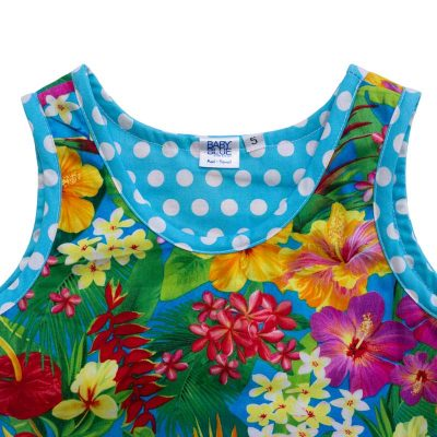 Close up view of the tank-top style top of a Baby Blue by Cool Blue Maui's Aloha Minnie Dress in a size 5 which has bright yellow, red, purple, and orange assorted Hawaiian tropical flowers and a blue with white polkadot hem.