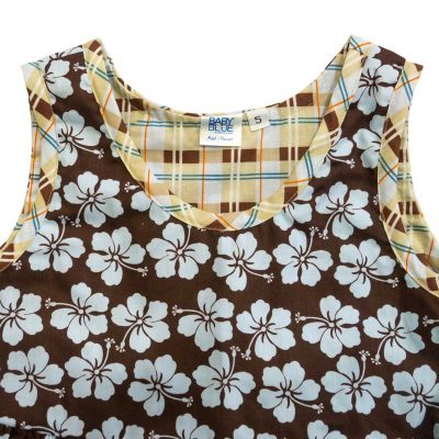 Close up view of the tank-top style top of a Baby Blue by Cool Blue Maui's Aloha Plaid Dress in a size 5 which has chocolate brown background with light blue hibiscus flowers and a blue, brown, yellow, orange plaid trim.