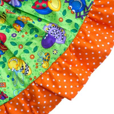 Close up fabric view of Baby Blue by Cool Blue Maui's Don't Bug Me Twirling Dress which has colorful funny looking cartoon bugs set on a bright lime green background with an orange polkadot hem.