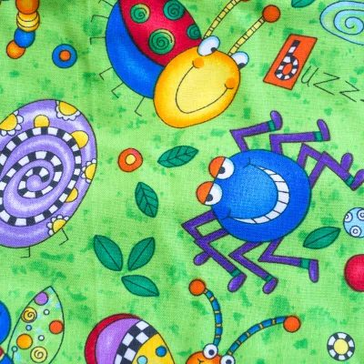 Close up fabric view of Baby Blue by Cool Blue Maui's Don't Bug Me Twirling Dress which has colorful funny looking cartoon bugs set on a bright lime green background.