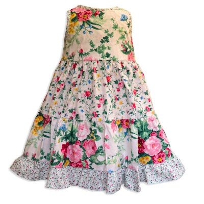 Invisible manikin view of the back side of the Baby Blue English Garden White Twirling Dress by Cool Blue Maui which has a white floral background with small pink roses, green leaves and large red and pink cabbage roses and a pink baby flower hem.
