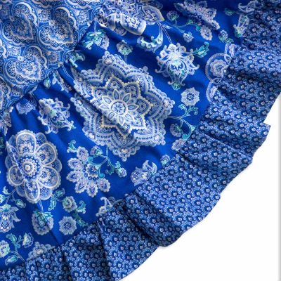 Close up view of the blue and silver mandala design fabric and hem of a Baby Blue Mandala Twirling Dress by Cool Blue Maui.