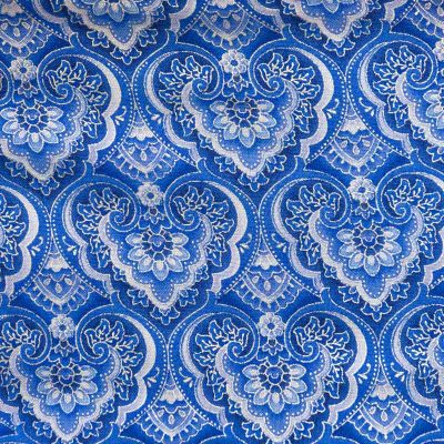 Close up view of the blue and silver heart shaped mandala design fabric of a Baby Blue Mandala Twirling Dress by Cool Blue Maui.