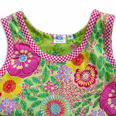 Close up view of the tank-top style top of a Baby Blue by Cool Blue Maui's Seahorse Garden Twirling Dress in a size 5 which has bright pink, red, blue and yellow flowers on lime green background with a pink checkered border.