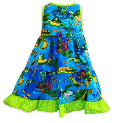 Invisible manikin view of the back side of the Baby Blue Turtle Town Twirling Dress by Cool Blue Maui which has a bright blue ocean background with swimming green sea turtles and a bright green polkadot hem.