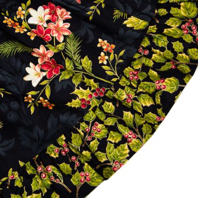 Fabric view of Holiday Bouquet Twirl Dress with the black background with roses, lilies, holiday flowers.